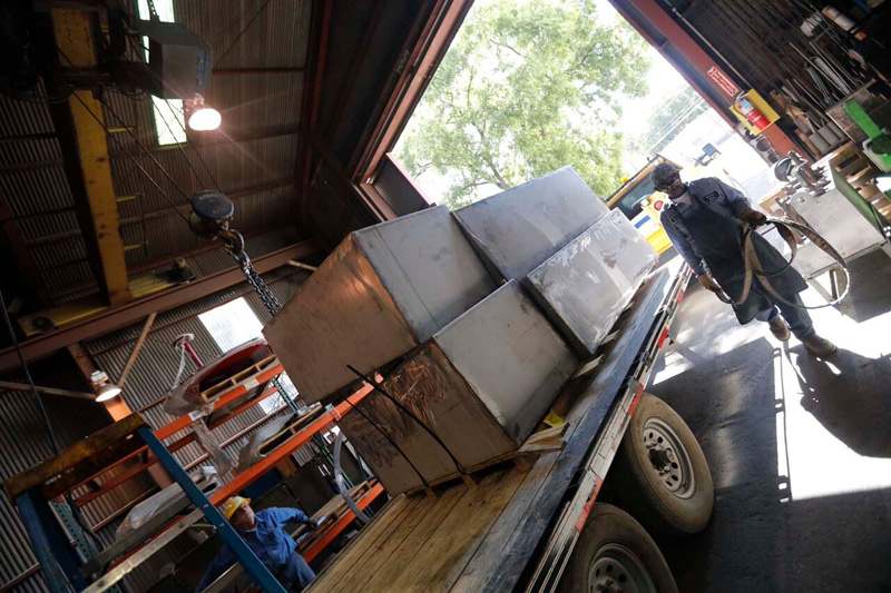 UL approved custom stainless steel storage tanks being loaded onto a couriers trailer for transport to the job site