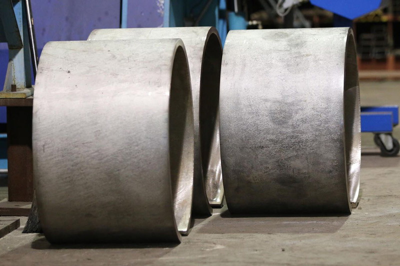 "Custom cylinders rolled from 1"" thick type 304 stainless steel"