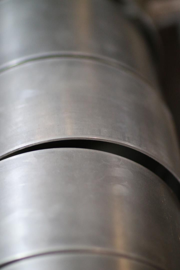 "Custom sheet metal cylinders rolled from 1/8"" stainless steel"